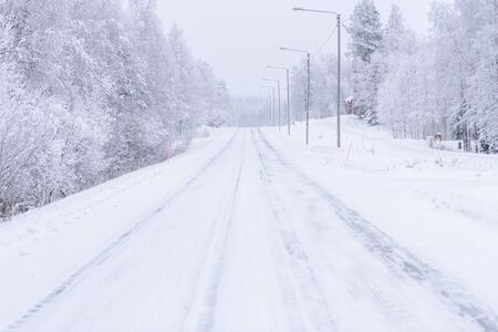 The road number 496 has covered with heavy snow in winter season at Lapland, Finland. Stock Photo