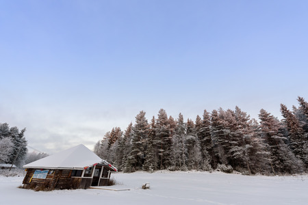 The house in the forest has covered with heavy snow and bad sky in winter season at Tuupovaara, Finland. Redakční