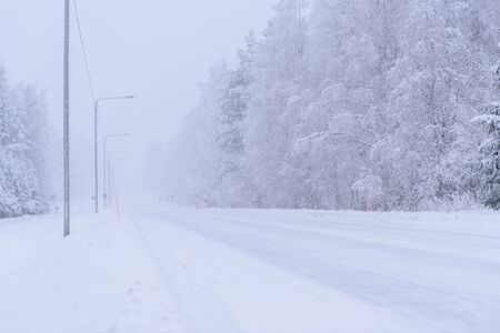 The road number 496  has covered with heavy snow and bad weather in winter season at Tuupovaara, Finland.