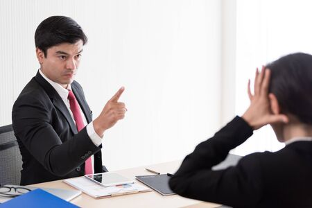 The manager has upset to employee woman with anger and unhappiness.