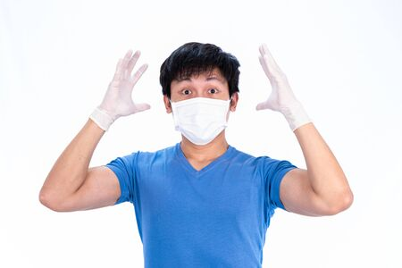 Asian young man in blue t-shirt top with medical mask and latex gloves to protect COVID-19 with isolated on white background concept.