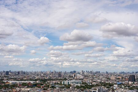The Bangkok cityscape from skyscraper view with clouds and blue sky.