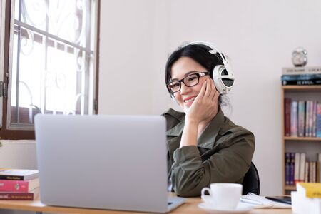 Modern young Asian woman working from home with happy, smile, and relax..