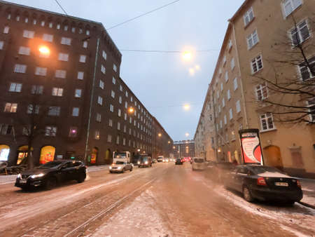 Editorial: Helsinki, Finland, 17th Mar 2020. The road and nature park during covid-19 pandemic social distancing isolation in Helsinki, Finland Редакционное