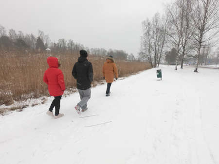 People have walked at a nature park during covid-19 pandemic social distancing isolation in Helsinki, Finland