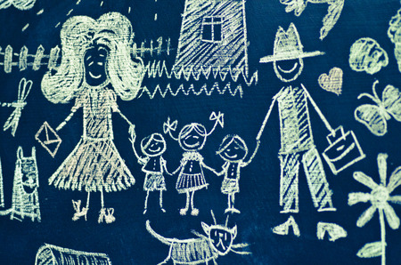 Drawing with chalk on blackboard large family of five people photo