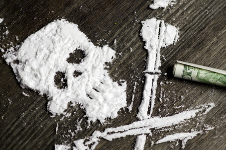 Drug powder cocaine in the silhouette of the skull Stock Photo