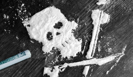 sniff: Drug powder cocaine in the silhouette of the skull Stock Photo
