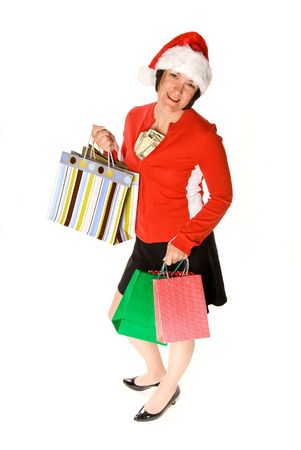 A woman displays her stylish shopping bags and a wad of cash during a holiday shopping spree Stock Photo - 1934110