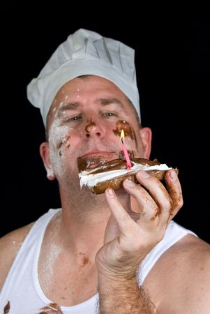 A chef examines his gourmet birthday creation consisting of burnt toast, chocolate and vanilla icing and a candle. Stock Photo - 1934109