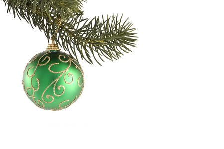 Christmas ornament hanging from a pine tree branch on a white background. photo