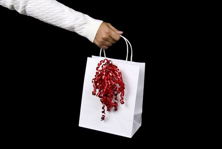Beautiful white shopping bag on black background setting for Christmas or Valentines Day photo