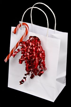 thrifty: Beautiful white shopping bag on black background setting for Christmas or Valentines Day