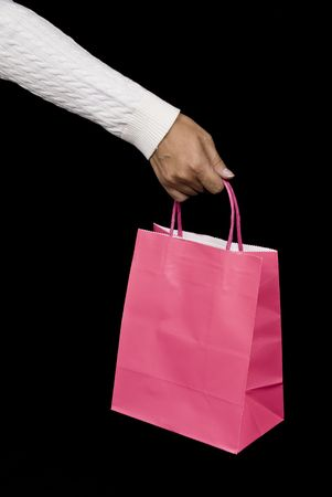 Pink shopping bag waiting to be filled with holiday goodies or Valentine delights photo