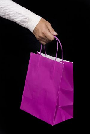 Purple shopping bag waiting to be filled with holiday gifts or Valentines delights photo