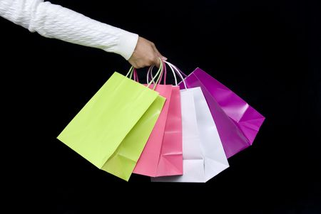 Shopping bag assortment waiting to be filled with holiday gifts or Valentines delights Stock Photo