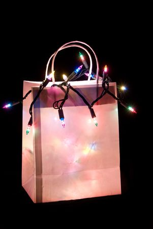 Shopping bag lit up with Christmas lights photo