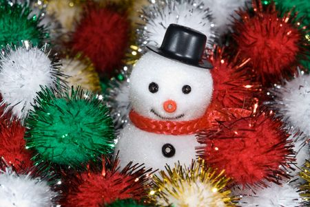 Snowman rests in a ball of colored tensile waiting for Christmas day photo