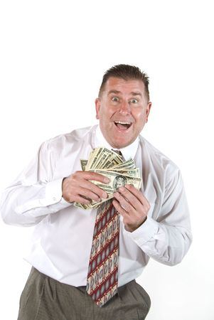 Businessman responds in joy after receiving cash for a job well done. Stock Photo - 1943125