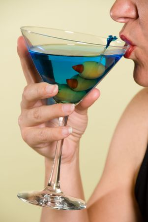Lady sips a blue martini during a business event Stock Photo - 1943049