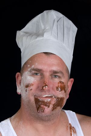 Chef grins after he attempted to cook his first chocolate and vanilla pastry item Stock Photo - 1943139