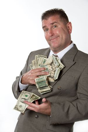 A businessman leans against a wall ready to count his cash Stock Photo - 1943267