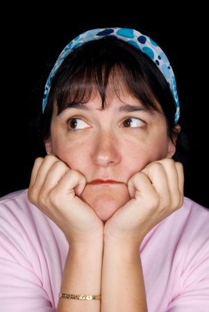 Woman pondering life.  She is set off by a blue hair wrap against a black background.