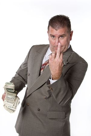 Executive gives the finger as he displays his wad of cash Stock Photo - 1943264