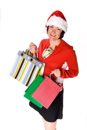 A woman displays her stylish shopping bags and a wad of cash during a holiday shopping spree Imagens