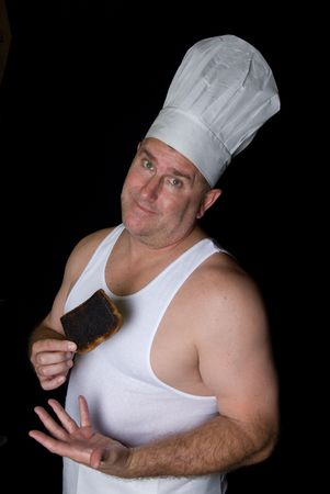 slob: Chef shows his failed creation of a burnt piece of toast Stock Photo