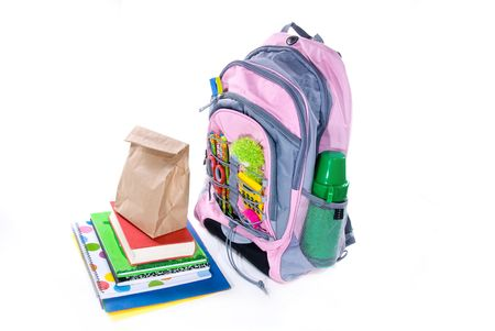 Elementary school students book bag, books and lunch wait for the bus to show up