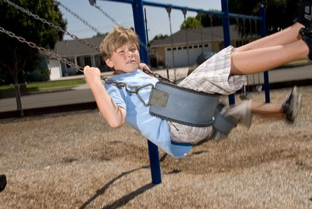 Student playing on a swing at a school playground photo