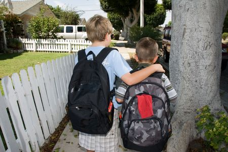 Two brothers walk to school photo