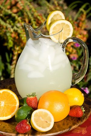 Bright and fruity refreshment ready to serve to thirsty summer picnic goers photo