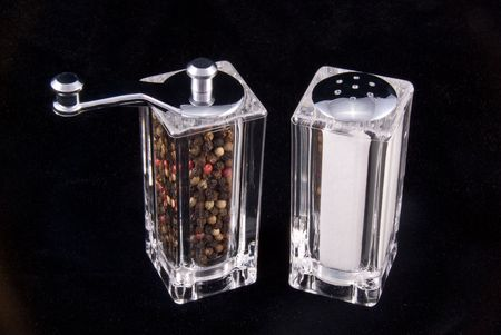Salt and pepper dispensers wait for chef mom to make a gourmet meal