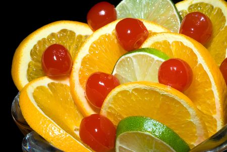 advocates: A dish of oranges and limes waits for health advocates to consume them.  The fragrance reminds one of being in a field of citrus trees during springtime.