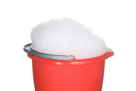 Bucket of foamy cleaning detergent waiting to be used photo