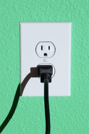 home appliances: A clean image of a 110 volt wall power outlet against a freshly painted wall.  Perfect image for any abstract energy promotion use or to make inferences for home design or appliance use.
