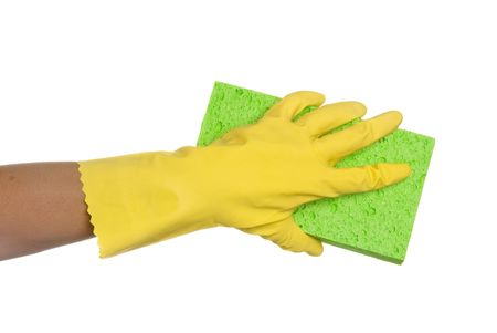 Worker protecting hand from detergents as they use a cleaning sponge. 写真素材