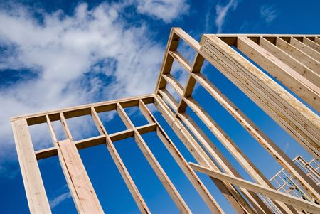 joist: Image shows a home under construction at the framing phase.  Ideal for roofing advertising and other home construction promotional inferences. Stock Photo