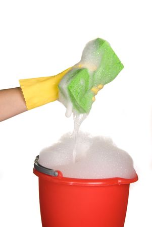 Worker protecting hand from detergents as they use a cleaning sponge. Stock Photo