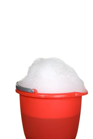 soap suds: A bucket of suds is ready for use to clean something.