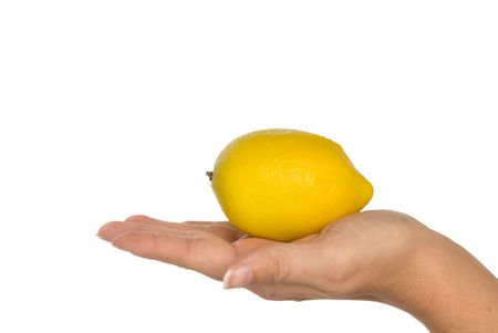 infer: Fresh lemon held in hand to infer freshness and healthy lifestyles. Isolated on a white background for easy manipulation by user. Stock Photo