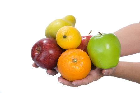 infer: Fresh selection of fruit held in hands to infer freshness and healthy lifestyles. Isolated on a white background for easy manipulation by user. Stock Photo