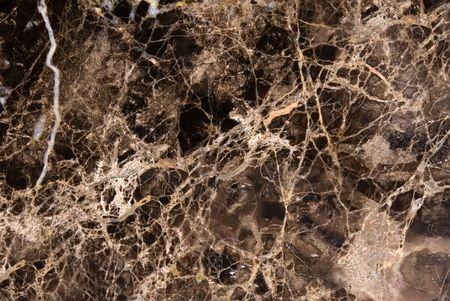 Black marble countertop shows excellent detail of the veins and colored patches photo