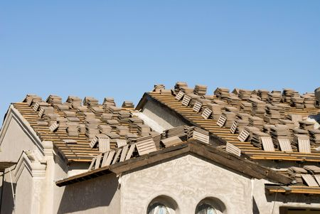 asphalt shingles: Image shows a home under construction at the roofing phase.  Ideal for roofing advertising and other home construction promotional inferences.