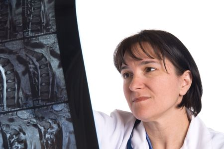 inference: Conceptual image of a doctor reviewing a patients MRI. Intended for any use where a medical inference is needed.
