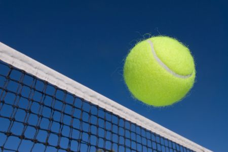 An image depicting the concept of tennis, including a ball gliding over the net.
