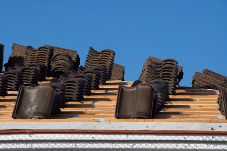 asphalt shingles: A new roof being constructed on a sunny day. Stock Photo