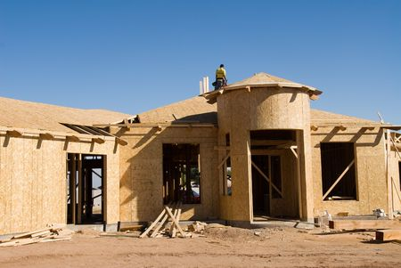 inferences: Image shows a home under construction at the roofing phase.  Ideal for roofing advertising and other home construction promotional inferences.